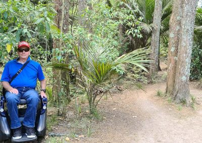 Man sitting on an Omeo on a forest walking track