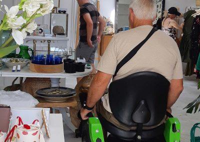 Man on an Omeo riding inside an upmarket gift shop.