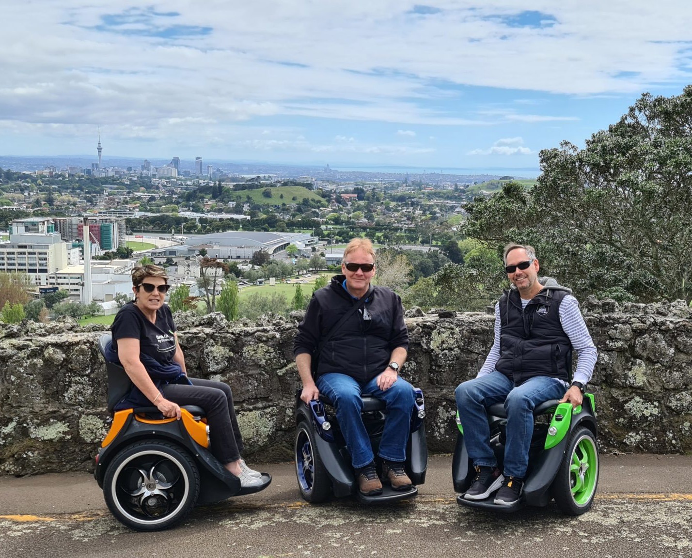 Three people using Omeos up a mountain in Auckland